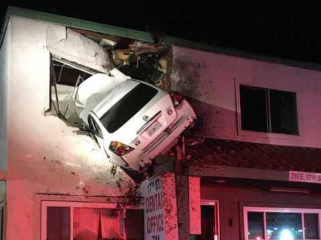 Motorist Loses Control, Launches Car Into Second Floor of Office Building