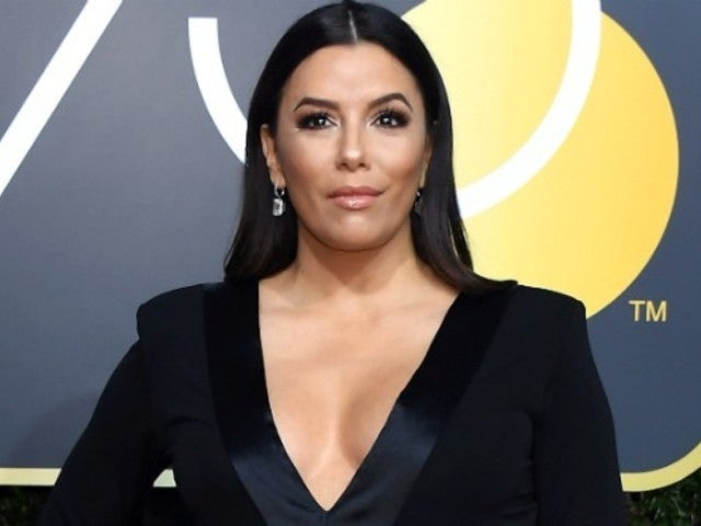Eva Longoria Spotlights Her Baby Bump at Golden Globes