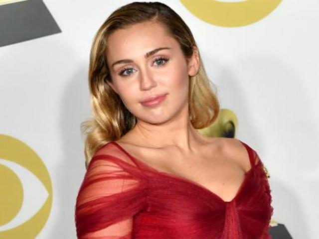 Miley Cyrus Stuns the Grammys With Flowing Red Dress