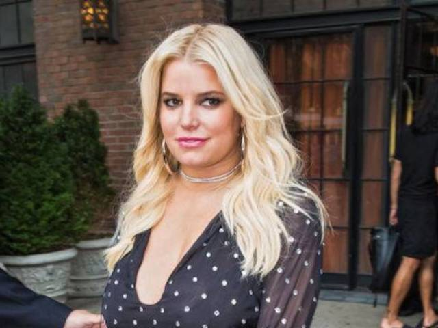 Jessica Simpson Shows off Beautiful Figure in a Plunging Cardigan