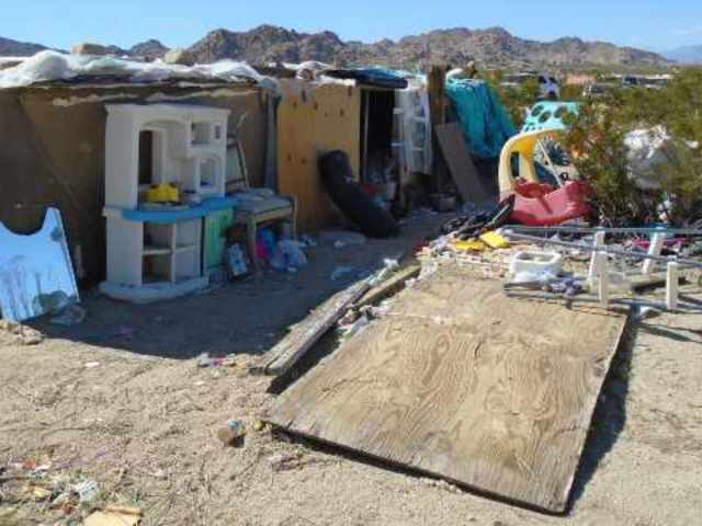 Parents Arrested After Children Found Living Inside a Box