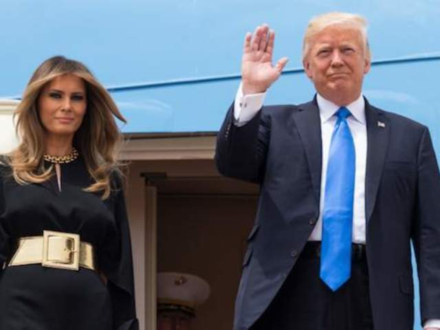 Watch President Trump's Awkward Attempt to Hold Melania's Hand