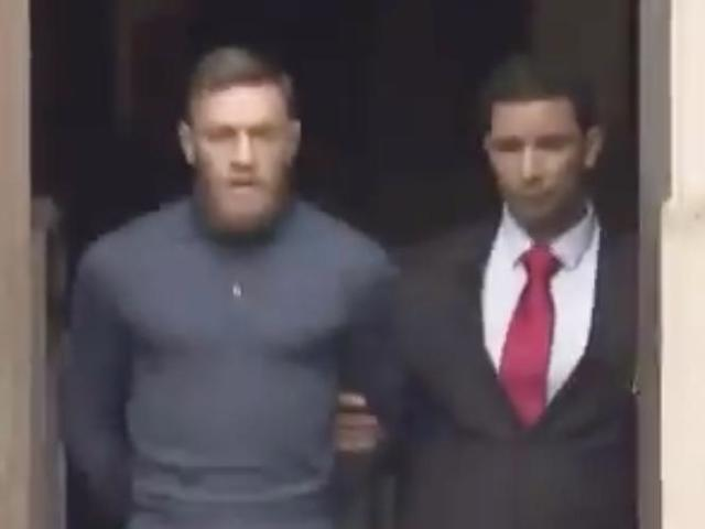 Watch: Conor McGregor Leaves Police Station Handcuffed After Being Charged for Bus Attack