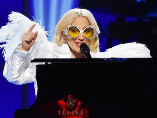 Lady Gaga Rocks Wild Feather Outfit During Elton John Tribute Show