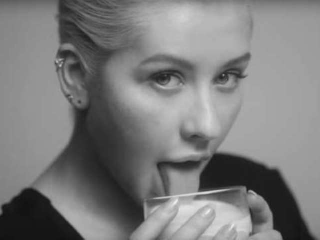 Christina Aguilera Drips Seduction in Sultry Photos From New Release