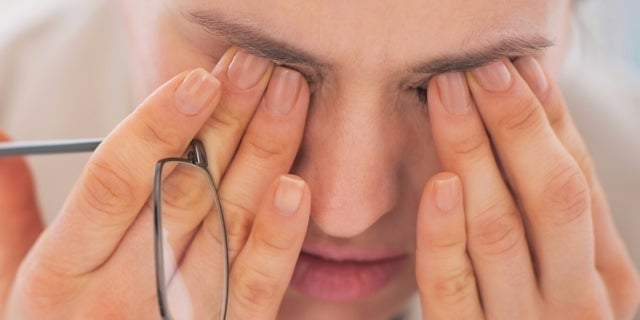 tired-woman-rubbing-her-eyes-1-53446