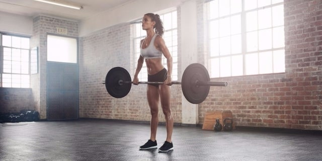 woman-lifting-weights-46585