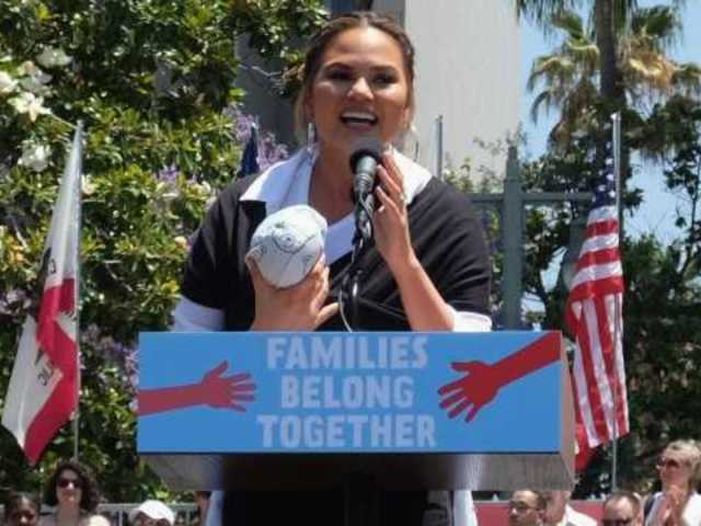 Chrissy Teigen Gives Impassioned Speech at Families Belong Together Rally With Help of Baby Miles
