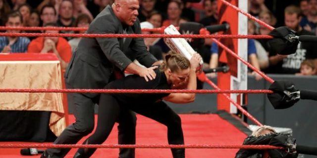 Ronda Rousey wwe kurt angle threat