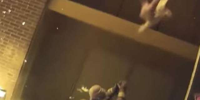firefighter-catches-baby-burning-building