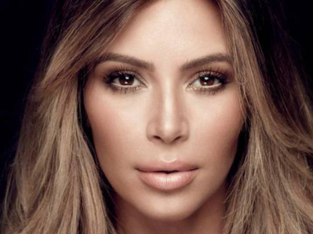 Kim Kardashian Rocks Tight White Top, Dreads in New Selfie