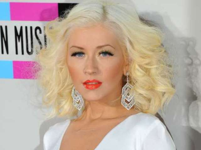 Christina Aguilera Claims She Tried to Kiss, Not Punch Pink