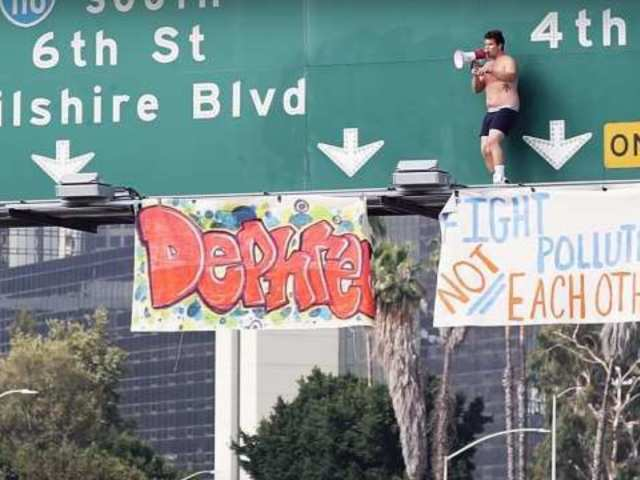 Watch: Man Backflips off LA Freeway Sign After Causing 2-Hour Traffic Standstill