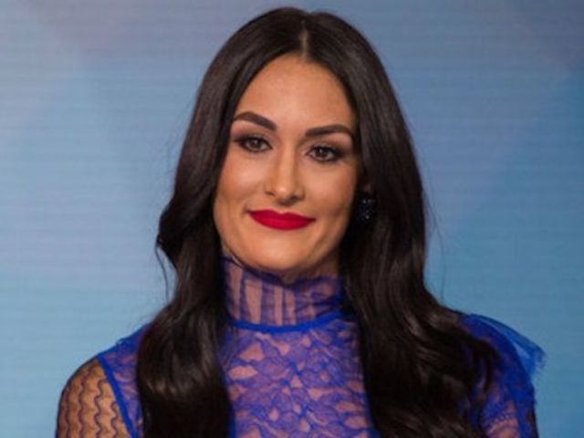 Nikki Bella Claims Photos With Mystery Man Were a Prank
