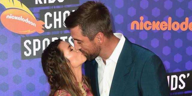 Danica Patrick And Aaron Rodgers Share A Kiss On Kids