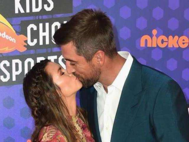 Danica Patrick and Aaron Rodgers Share a Kiss on Kids' Choice Sports Awards Red Carpet