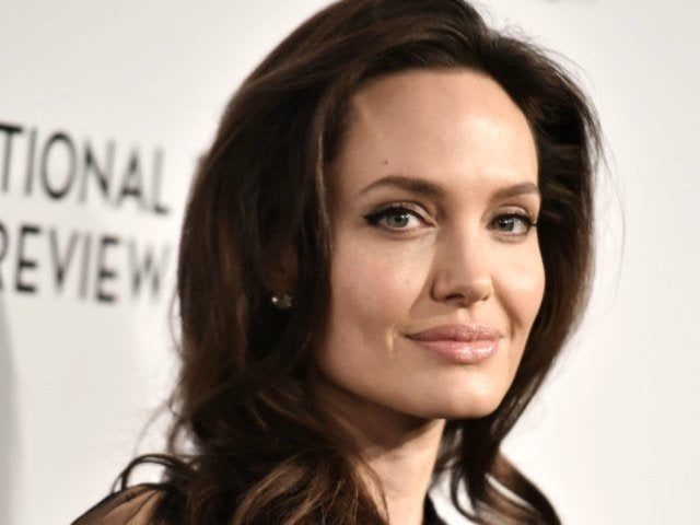 Angelina Jolie Shows off New and Old Tattoos in Sultry Fragrance Commercial