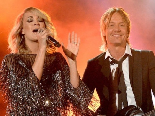 Carrie Underwood's Baby Bump Makes On-Stage Debut With Keith Urban