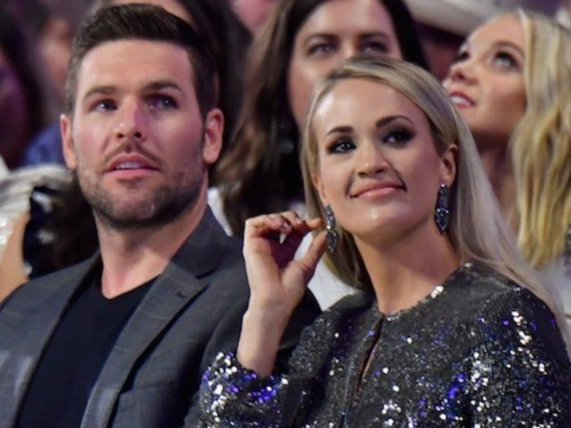 Carrie Underwood Jokes That She Kicked Husband Mike Fisher's 'Booty' After fit52 Workout