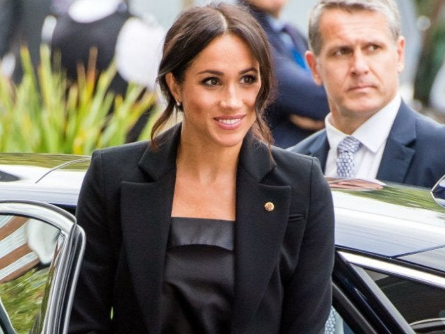 Meghan Markle Accompanied by MI5 Agent on 'Suits' Set