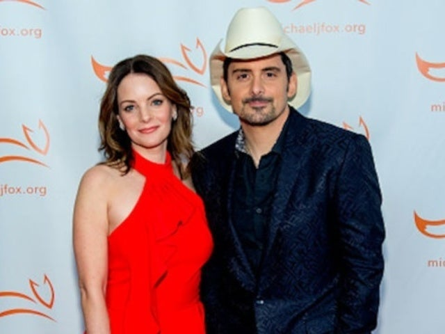 Brad Paisley's Wife Kimberly Shares Birthday Photo of Her Husband Holding a Large Snake