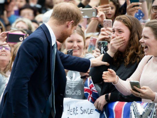 Prince Harry Fan Breaks Down After He Stops to Hug Her