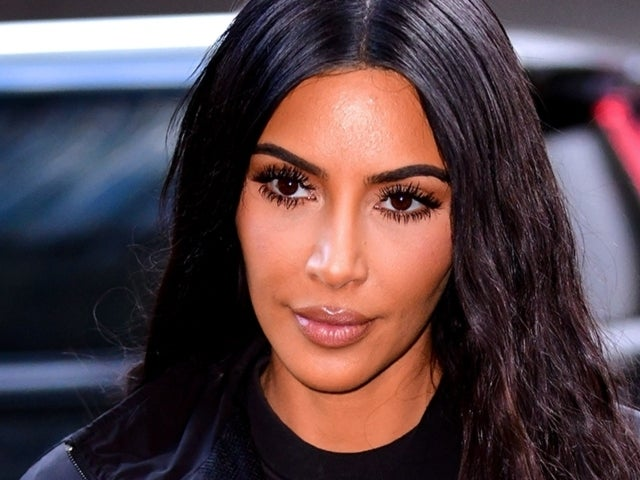 Kim Kardashian Reveals Diamond Cross Grill in New Jewelry Look