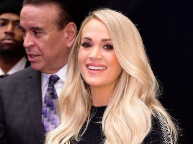 Carrie Underwood Shows off Baby Bump in Curve-Hugging Black Dress