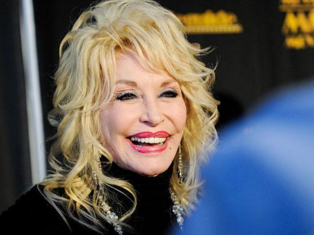 Dolly Parton Dishes on the Secret to 52-Year Marriage to Husband Carl Thomas Dean: 'Stay Gone'
