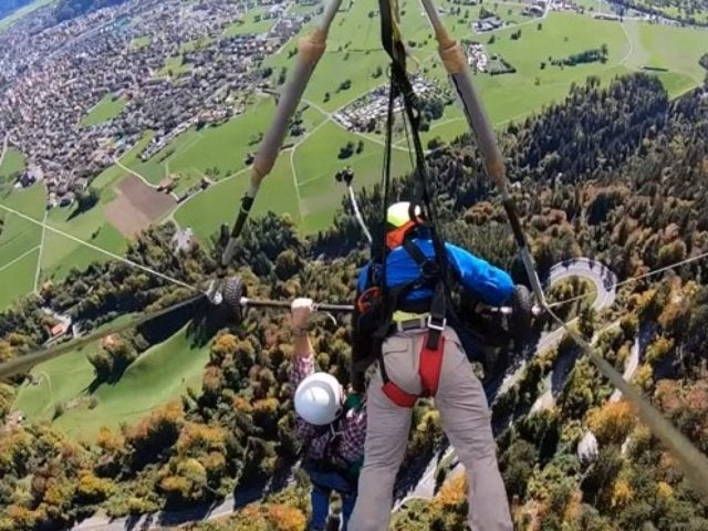 Hang-Gliding Tourist Clings for His Life After Realizing Harness Isn't Attached