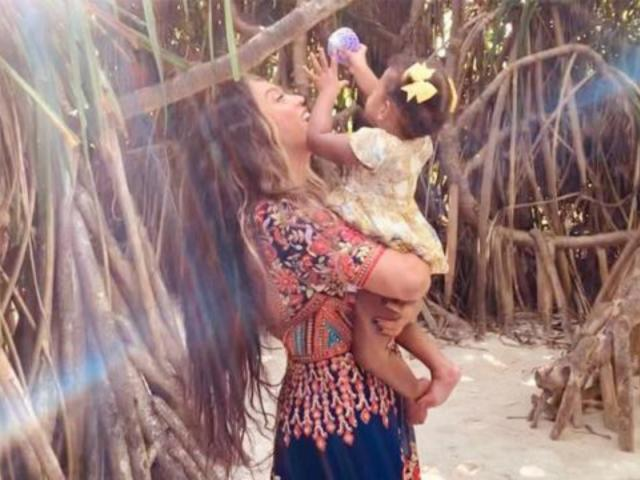 Beyonce Gives Sweet Look at Twins Rumi and Sir Carter From Beach Vacation