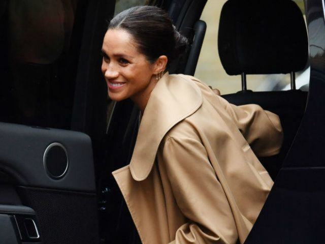 Pregnant Duchess Meghan Markle Wears Baby Bump-Hugging Dress During Royal Charity Event