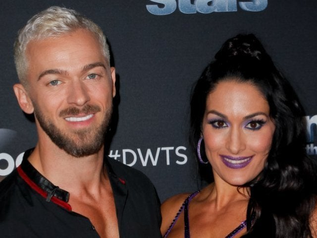 Nikki Bella and 'DWTS' Pro Artem Chigvintsev Hold Hands in Romantic Photo