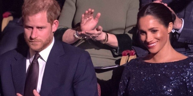 Prince Harry Edges in Sweet PDA With Meghan Markle During Royal Outing