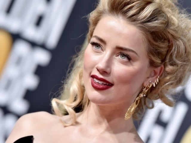 Amber Heard Kisses 'It' Director Andy Muschietti Amid Legal Battle With Ex Johnny Depp