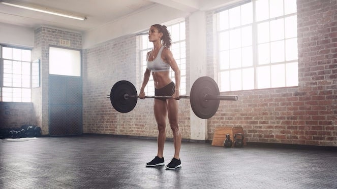 woman-lifting-weights-46585
