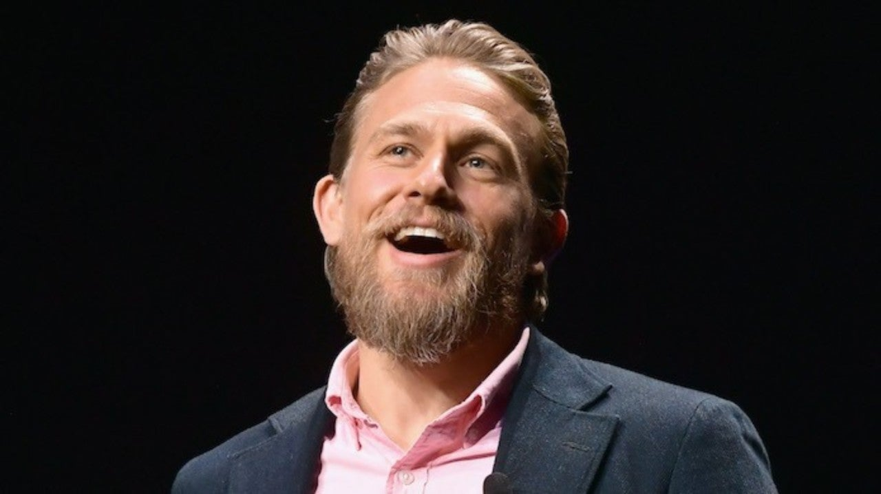 Charlie Hunnam Happily Snaps Photos With Fans After They Show Up