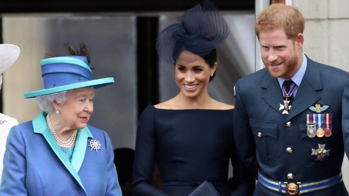 queen elizabeth meghan markle prince harry chris jackson