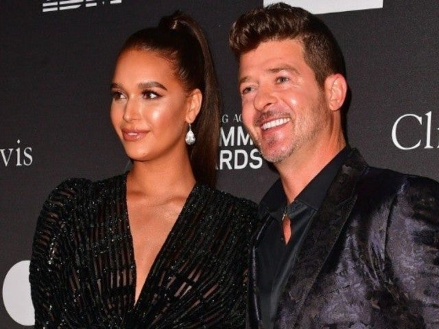April Love, Robin Thicke's Fiancee, Reacts to Video of Him Hugging Khloe Kardashian