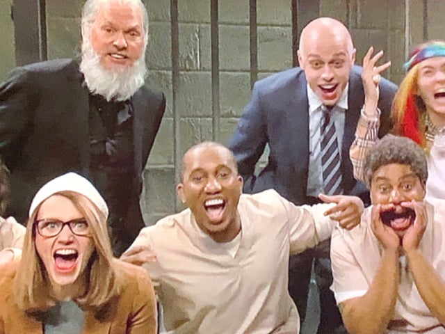 'SNL' Cold Open Roasts Lori Loughlin, Julian Assange With Michael Keaton
