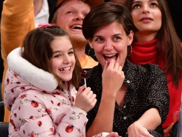 Suri Cruise and Mom Katie Holmes Enjoy Night out Seeing Moulin Rouge on Broadway