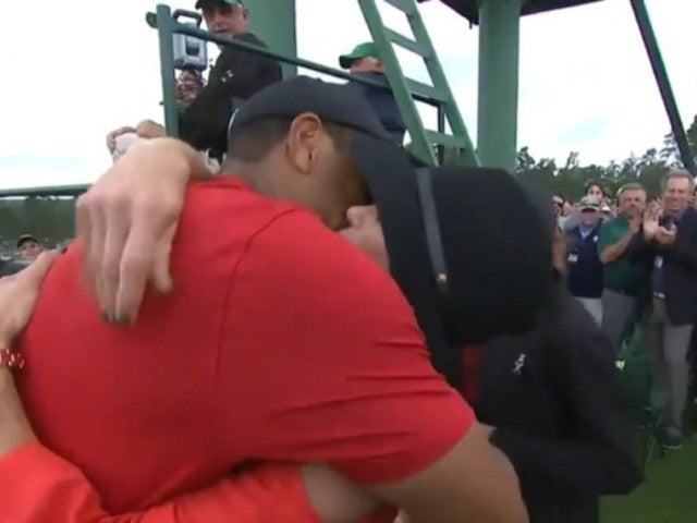 The Masters: Watch Tiger Woods Kiss Girlfriend Erica Herman