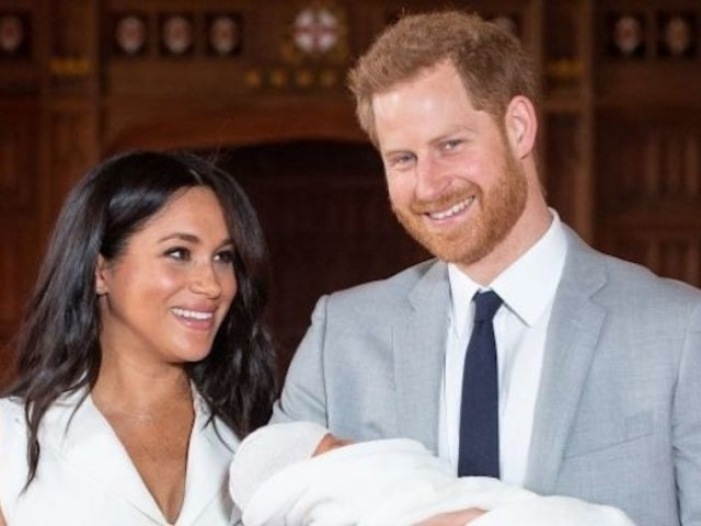 Meghan Markle and Prince Harry Pose in First Revealed Royal Baby Photo