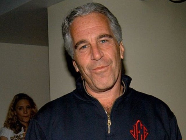 Jeffrey Epstein Had Bizarre Picture of Bill Clinton in Blue Dress With Red Heels Inside Manhattan Home