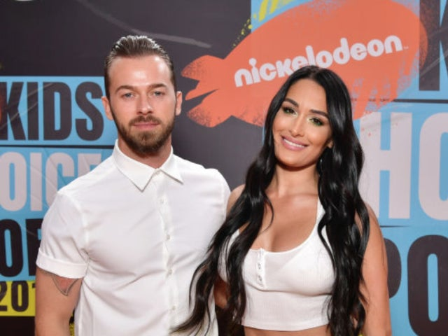Nikki Bella and Artem Chigvintsev Kiss During Red Carpet Debut at Nickelodeon Kids' Choice Sports Awards