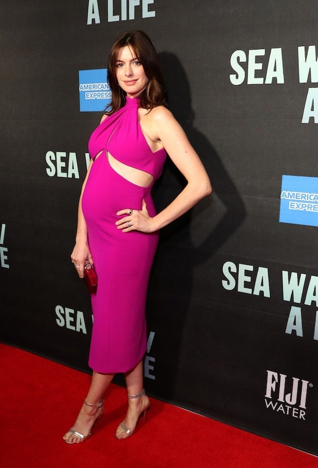 Anne Hathaway Debuts Baby Bump On Red Carpet With