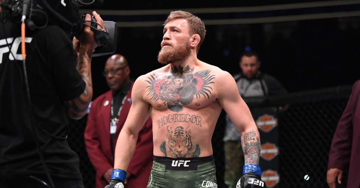 Conor McGregor bar punch bully with money