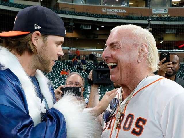 Astros Outfielder Josh Reddick Greets Ric Flair on Field in Wrestling Attire