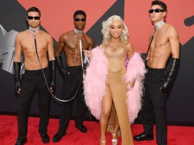 VMAs 2019: Nikita Dragun Stuns Twitter With Leashed Shirtless Men on Red Carpet