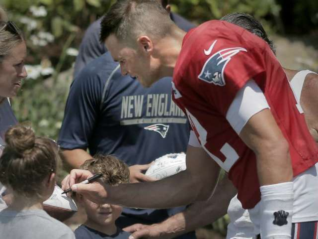 Patriots Fans Mob Tom Brady for Autographs at Training Camp